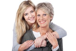 Older woman hugging a younger woman both smiling l Tooth-colored fillings Summerville SC