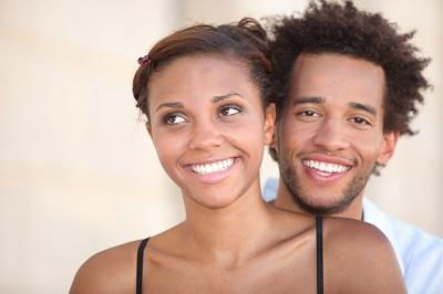Young couple smiling together l Tooth-Colored Fillings Azalea Dental