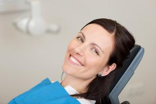 woman laying in dental chair smiling I root canal in summerville sc