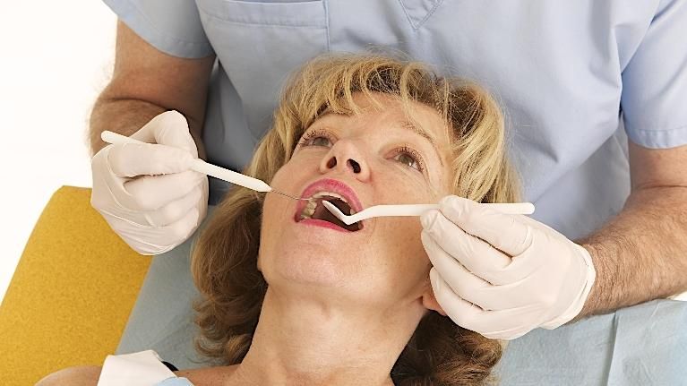 Woman Getting Teeth Checked | dentist near weatherstone